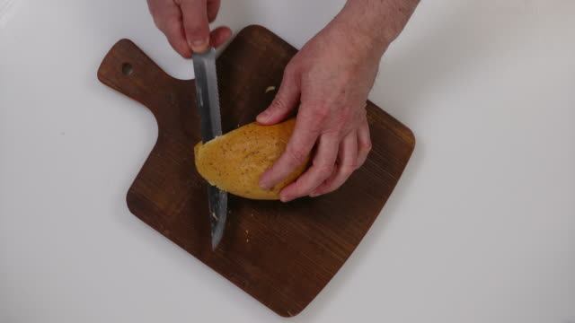 cutting of bun. - brown bread stock videos and b-roll footage