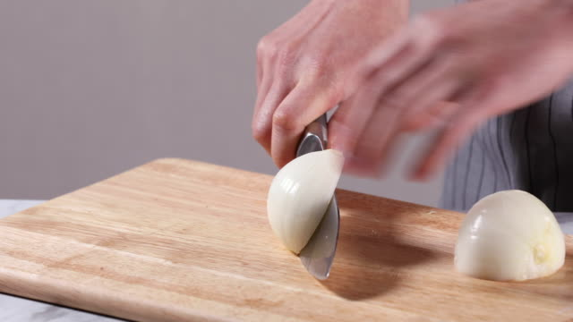 cutting onion with a knife on the chopping board - good condition stock videos & royalty-free footage