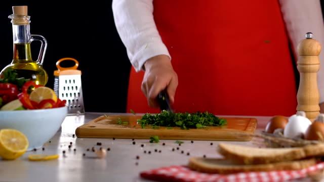 Cutting Parsley on Chopping Board Slow Motion