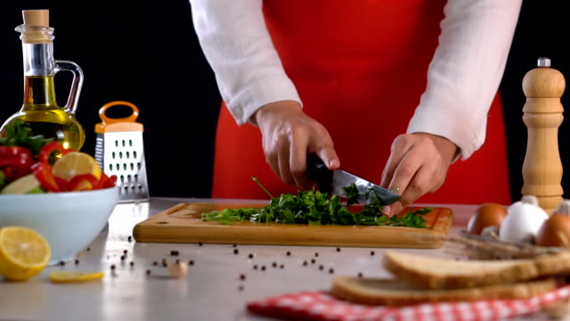 cutting parsley on chopping board - parsley stock videos and b-roll footage