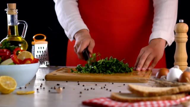 Cutting Parsley on Chopping Board