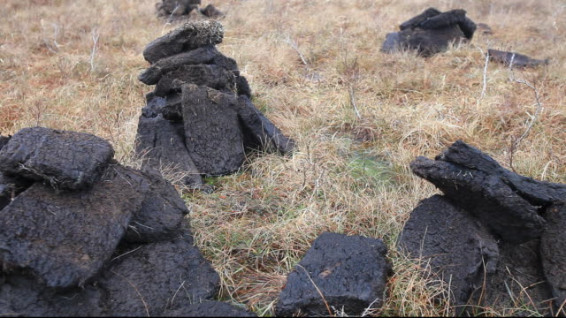cutting peat for fuel, broadford, isle of skye, scotland, uk. - bog stock videos & royalty-free footage