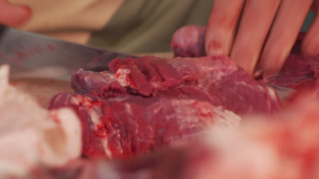 cutting pork meat into pieces - butcher stock videos & royalty-free footage