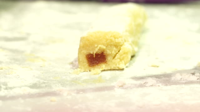 cutting quince panellets dough in the kitchen - quince stock videos & royalty-free footage