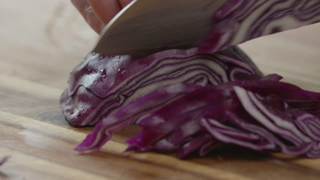 cutting red cabbage - cutting stock videos & royalty-free footage