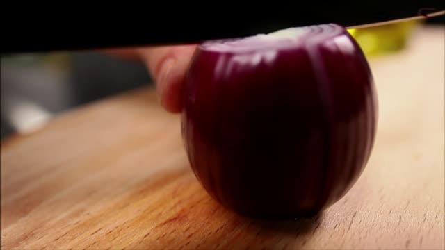 cutting red onion - red onion stock videos & royalty-free footage