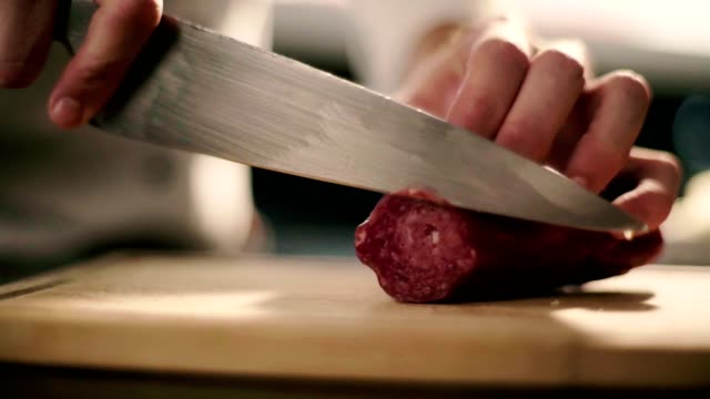 cutting salame sausage - cutting stock videos & royalty-free footage