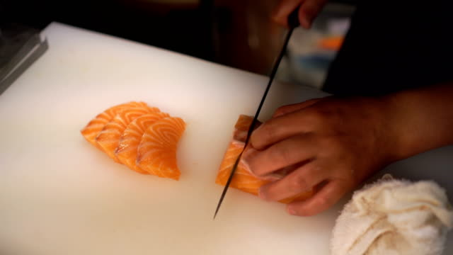 cutting salmon sashimi - sushi stock videos and b-roll footage
