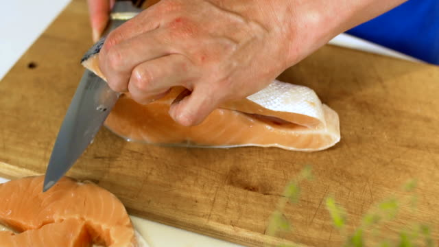 cutting salmon, slo mo - marinated stock videos and b-roll footage