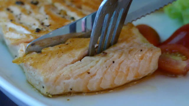cutting salmon steak - slowmotion