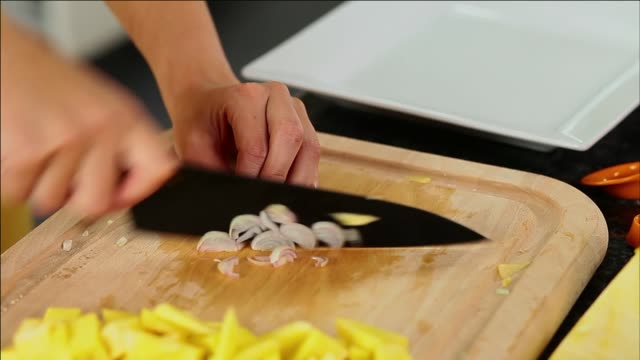 cutting shallot - shallot stock videos & royalty-free footage