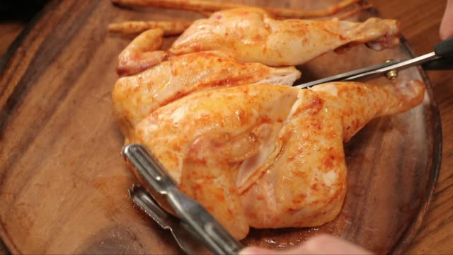cutting spicy chicken cooked with sous-vide(low-temperature) recipe - scissors stock videos & royalty-free footage