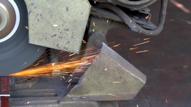 cutting steel with machine for cutting steel by worker - blade stock videos & royalty-free footage