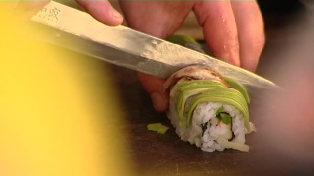 cutting sushi - rolled up stock videos & royalty-free footage