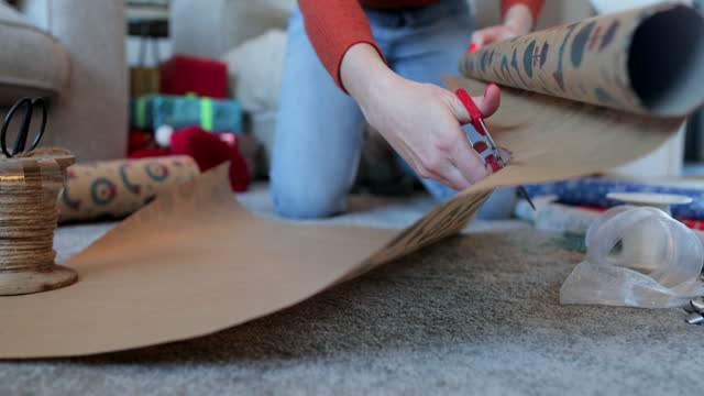cutting the paper to size - christmas wrapping paper stock videos & royalty-free footage
