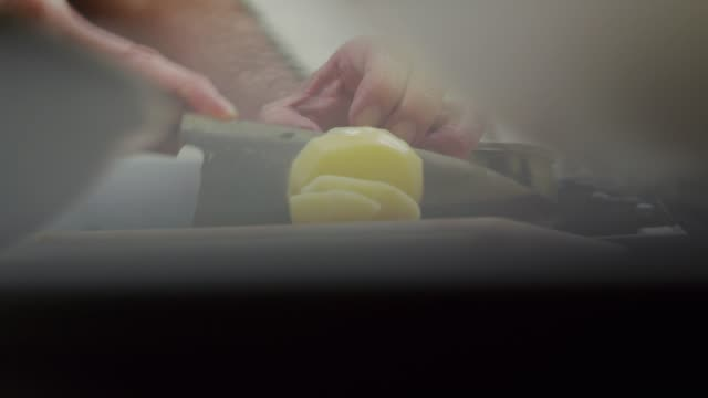 cutting the potatoes in tokyo, japan - domestic kitchen stock-videos und b-roll-filmmaterial