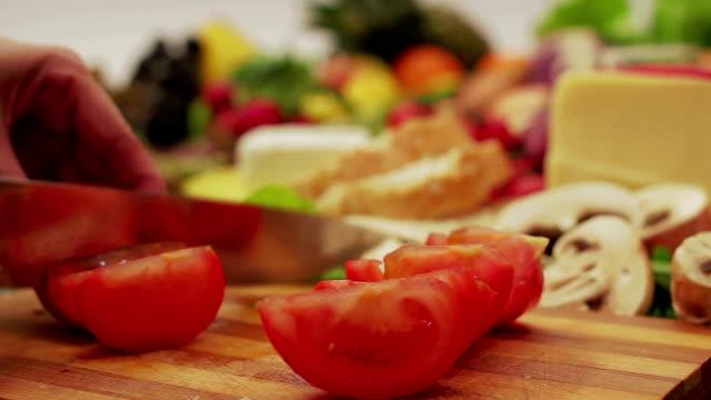 Cutting tomato.