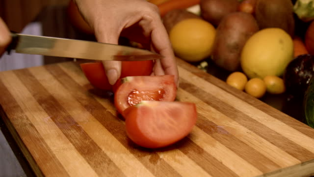 Cutting Tomatoes Into Parts