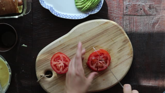 cutting tomatoes - stationary process plate stock videos & royalty-free footage