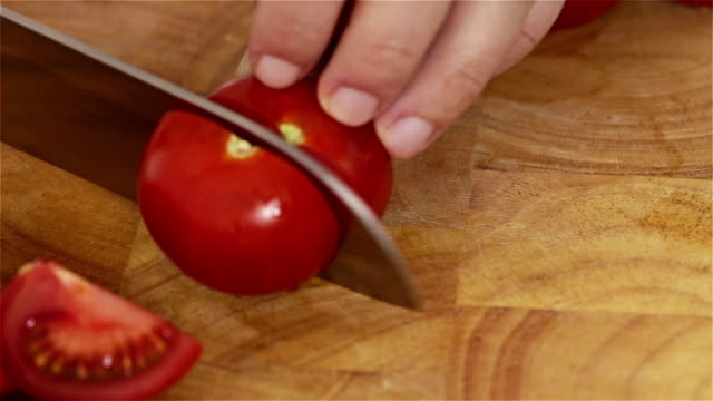 cutting tomatoes - medium group of objects stock videos & royalty-free footage