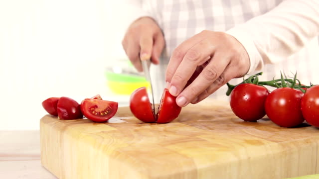 cutting tomatoes - chopping board stock videos & royalty-free footage