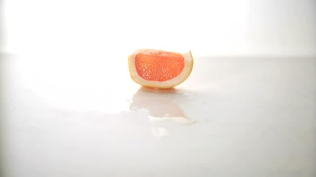cutting up a grapefruit piece