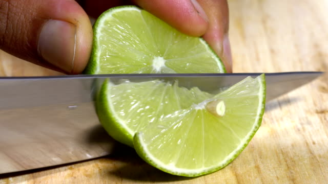 cutting up a lime - lime stock videos and b-roll footage