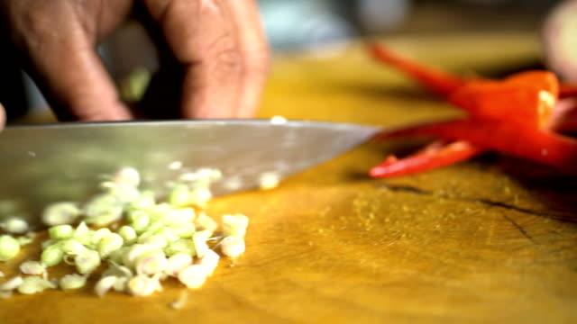 vídeos y material grabado en eventos de stock de cutting vegetables on board with balinese blakas indonesia - colesterol