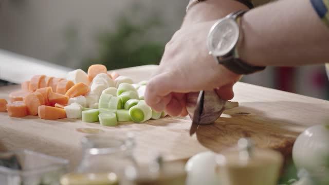 cutting vegetables - garlic stock videos & royalty-free footage