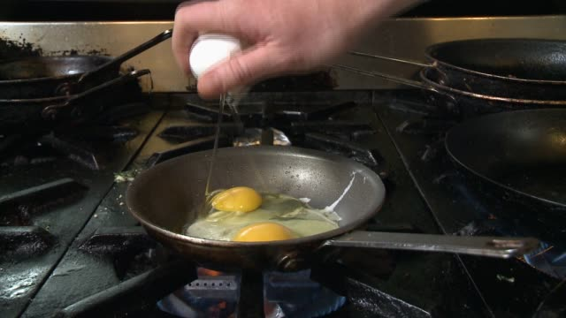 cutting veggies and sautéing eggs with final preparation - saute stock videos and b-roll footage