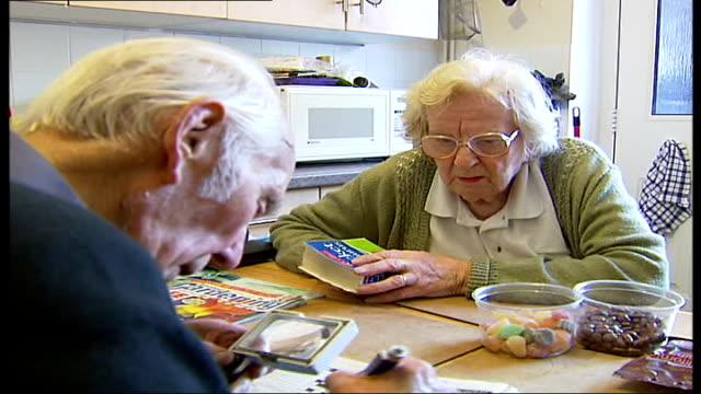 duke of edinburgh to visit wreckage; epsom: int palmer doing crossword at kitchen table - crossword stock videos & royalty-free footage