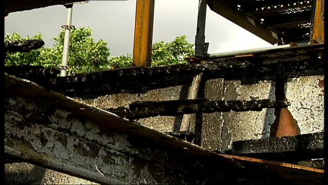 renovation appeal **stephen archer interview partially overlaid sot** charred black wooden struts and other firedamage inside boat hull - 船の一部点の映像素材/bロール