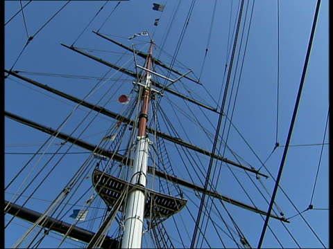 cutty sark general views / james cracknell photocall; low angle views of ship silhouetted against sun / deck of cutty sark, more of rigging, mast /... - rigging stock videos & royalty-free footage