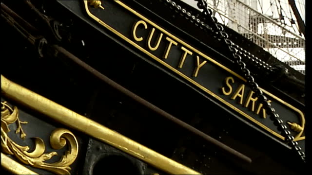 cutty sark restoration project underway: general views of cutty sark; hull of cutty tilt up up carved mast figurehead / close up of gold lettering... - rigging stock videos & royalty-free footage
