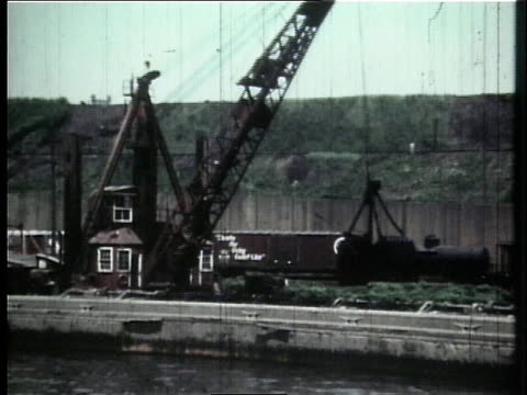 1966 montage cuyahoga river being dredged / ohio, united states - fiume cuyahoga video stock e b–roll