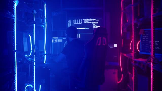 cyber attack or computer crime hacking password on a dark background - fare la guardia video stock e b–roll