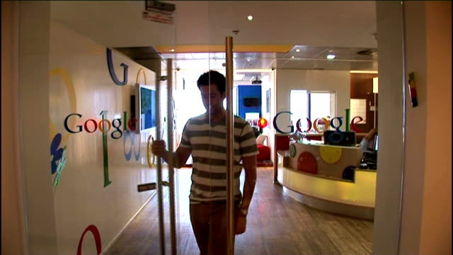 cyber attacks may be one of biggest threats facing britain employee towards through doors with google logo lava lamps in google offices google logo... - google stock videos & royalty-free footage