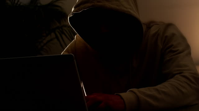 cyber crime hoodie hacker. handheld. - unrecognisable person stock videos & royalty-free footage