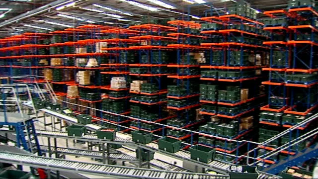 Busiest online shopping day of the year ENGLAND Hertfordshire Hemel Hempstead INT Close Shot Worker packing box in Amazon warehouse TO Milton Keynes...