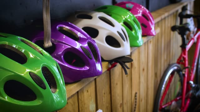 cycle helmets on display in shop - sports equipment stock videos & royalty-free footage