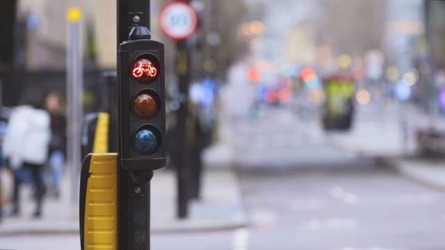 cycle lane lights changing from red to green - day stock videos & royalty-free footage