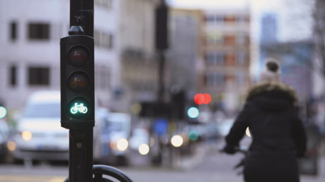 cycle lane lights changing from red to green - road sign stock videos & royalty-free footage