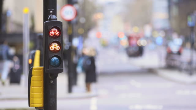 cycle lane lights changing from red to green - traffic light stock videos & royalty-free footage
