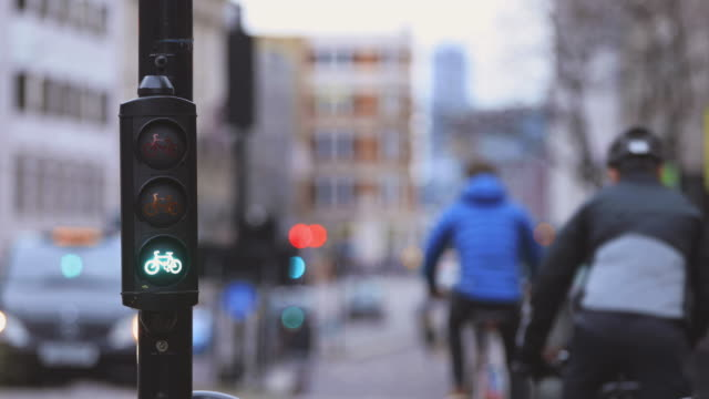 cycle lane lights in city - segnaletica stradale video stock e b–roll