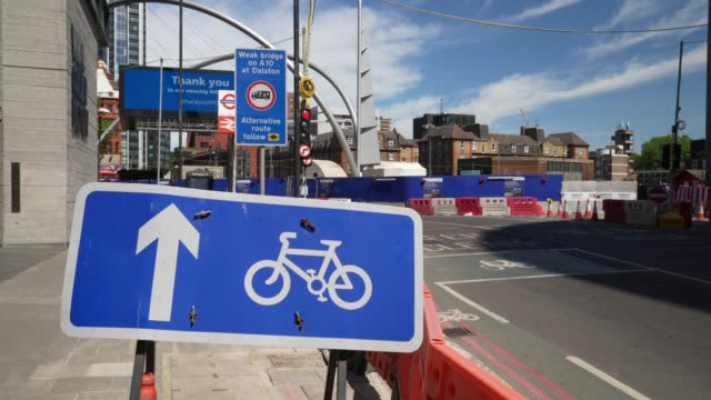 a cycle signs is added along the road to direct cyclist in the direction of a new cycle lane at old street roundabout due to the coronavirus covid19... - cycling stock videos & royalty-free footage