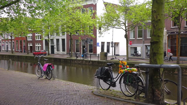 MS Cycle stand near canal at Lage Gouwe, old town of Gouda / Gouda, South Holland, Netherlands