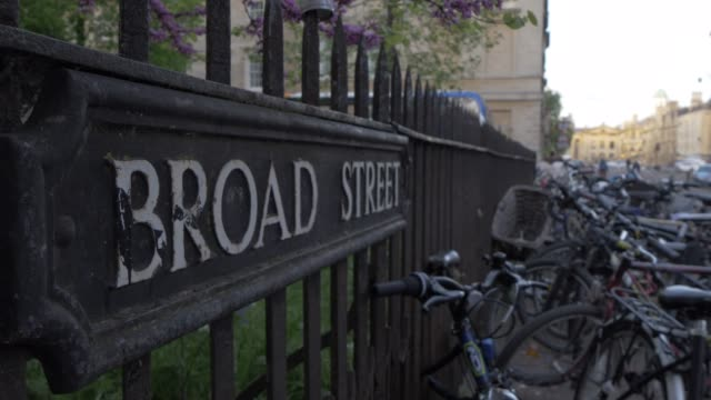 cycles on broad street and sign, oxford, oxfordshire, england, united kingdom, europe - oxford england stock videos & royalty-free footage
