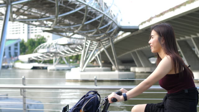 cycling a bicycle in the city - singapore stock videos & royalty-free footage