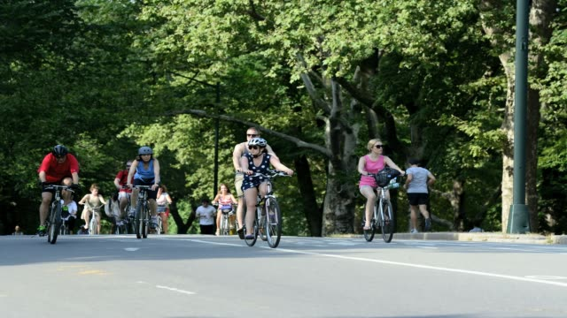 LAPSE Cycling and running during summer in Central Park Manhattan New York City USA