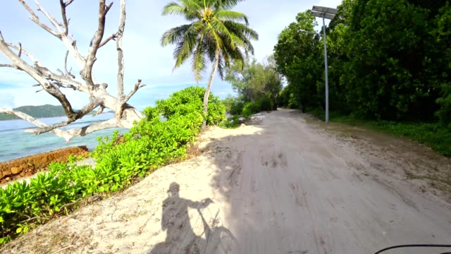 pov: cycling at la digue island, seychelles - seychelles stock videos & royalty-free footage